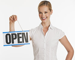 250px business owner with open sign shutterstock_35125528